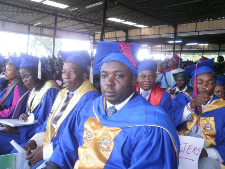 Patrick-Ekema-Mayor-of-Buea1st-on-front-row-graduated-with-a-Masters-Degree-in-History-at-the-18th-Convocation-Ceremony.jpg